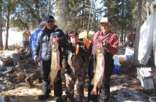 From left, Melvin Fortier, Ethan Gillis and Richard Mercredi hold the winning catches for the weekend spent at Natawa, Blackman and Jackfish Lakes.
