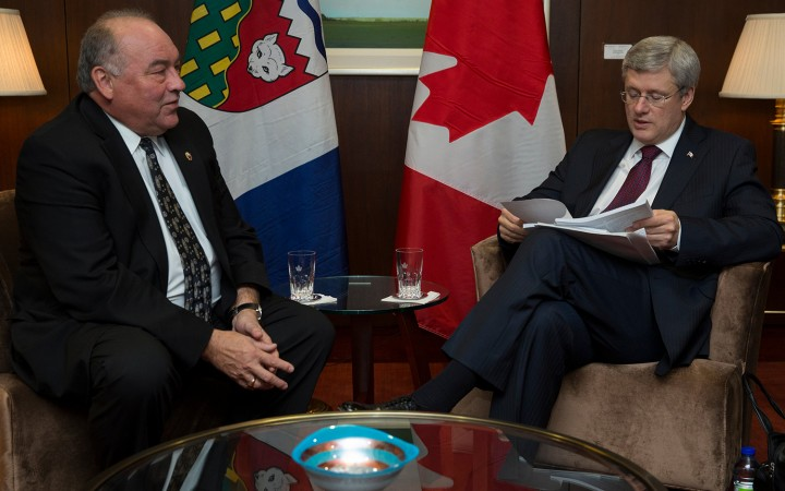 NWT Premier Bob McLeod, left, credits successful meetings with Prime Minister Stephen Harper for the increased borrowing room.