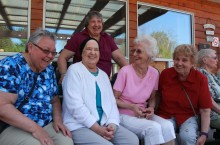 Louise Fraser, left, Karen Price, Milly Steed, Betty Masson and Karen Mabbitt, back, have a laugh outside the Northern Lights Special Care Home during the Cancer Survivor's Lunch, hosted by the Fort Smith Relay for Life committee, in their honour.