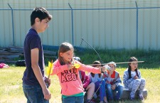 Ashlynn Daniels tries her hand at archery, also learning the Cree words for rabbit (wâpos) and duck (sêsêp).