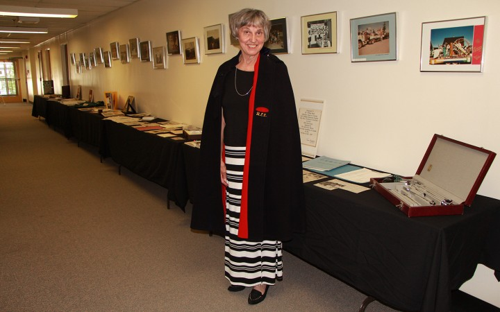 Retired matron Ruth Webb shows off her nurse's cape at the 50th anniversary celebration of the H.H. Williams Hospital, held on June 27. Webb donated the cape, which will  eventually be displayed along with other memorabilia at the community museum.