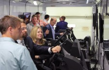 Federal and provincial leaders test out new mobile training simulator units for the heavy equipment operator program at Keyano College's Fort McMurray campus on June 25.