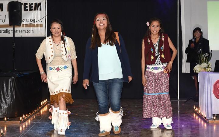 Cindy Gon, left, Belinda Blackduck and Karisha Koying from Gameti show off original designs during the Tlicho Aboriginal Day fashion show.