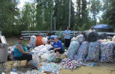 Jennifer Cheezie, left, and a group of volunteers sort the more than $1,000 in recycling raised to help the Lafferty family.