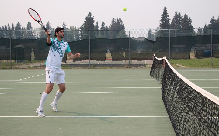 Justin Lalonde of Yellowknife competes in the men's singles final at the Fort Smith Open tennis tournament on Sunday afternoon. Lalonde came in second against Fort Smith's Bernie Bennett, who has taken the title over Lalonde for the last three years.